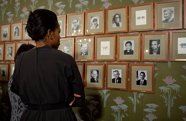 Michelle Obama Looks At Pictures Print by Everett