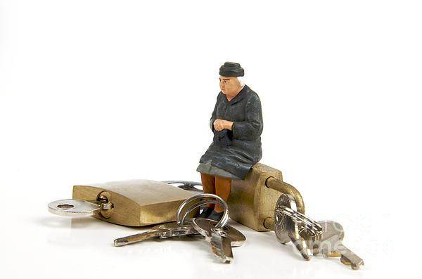 Miniature Figurines Of Elderly Sitting On Padlocks Print by Bernard Jaubert