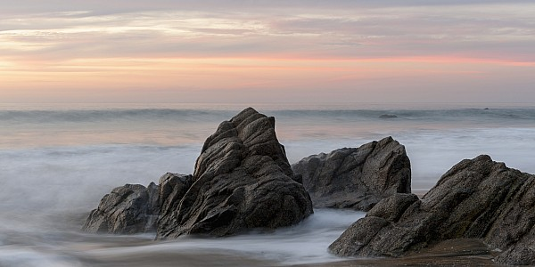 Mist Surrounding Rocks In The Ocean Print by Keith Levit