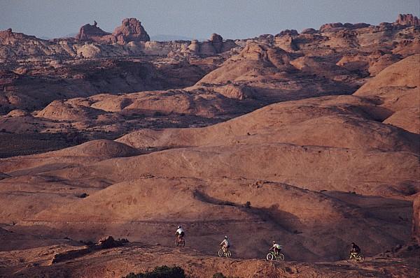 Mountain Bike Riders On Slickrock Trail Print by Joel Sartore