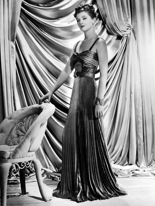 Myrna Loy Wearing Green And Yellow Gold Print by Everett