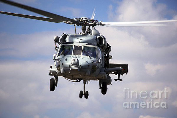 Navy Pilots In A Sh-60f Seahawk Conduct Print by Michael Wood
