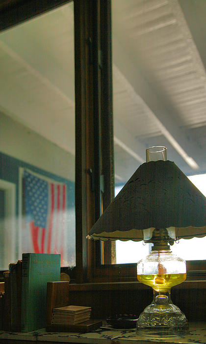 Oil Lamp And Porch Print by Steven Ainsworth