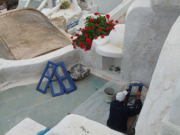 Painting Shutters In Santorini Greece Print by Nikki Borden