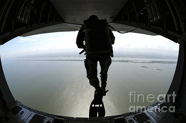 Pararescuemen Train On The Banana River Print by Stocktrek Images