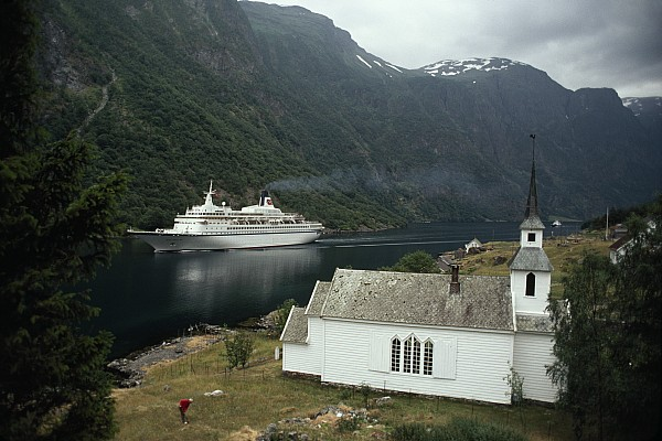 Passenger Ship Cruising The Fjords Print by Paul Chesley