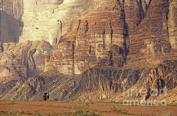 Person Riding A Motorbike Through The Wadi Rum Desert In Jordan Print by Sami Sarkis