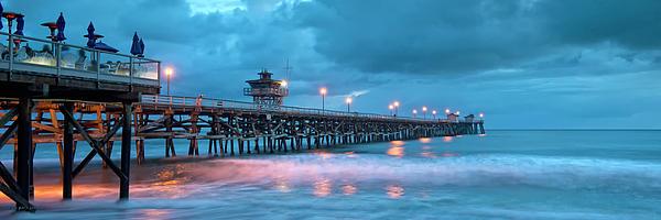 Pier In Blue Panorama Print by Gary Zuercher