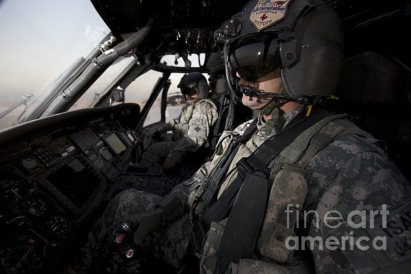 Pilot In The Cockpit Of A Uh-60l Print by Terry Moore