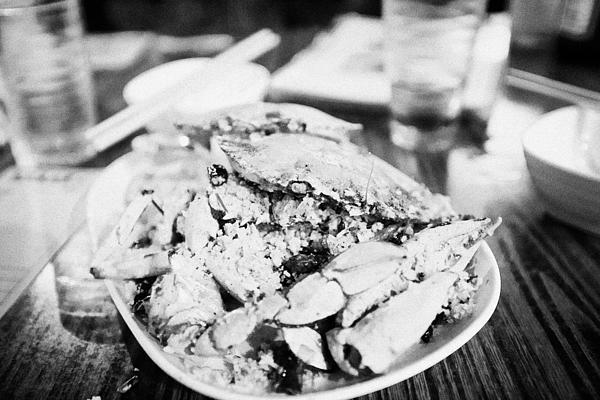 Plate Of Spicy Crab Seafood At A Table In An Outdoor Cafe At Night Kowloon Hong Kong Hksar China Print by Joe Fox