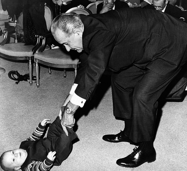 President Lyndon Johnson Tugs The Legs Print by Everett