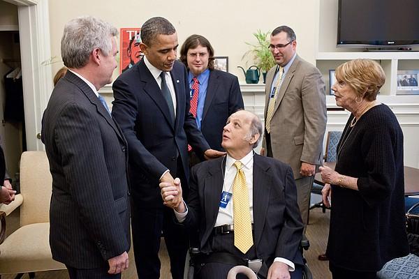 President Obama Greets James Brady Print by Everett