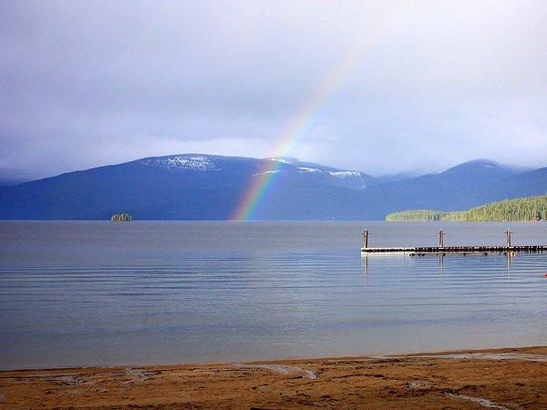 Rainbow Over Priest Lake Print by Carol Groenen