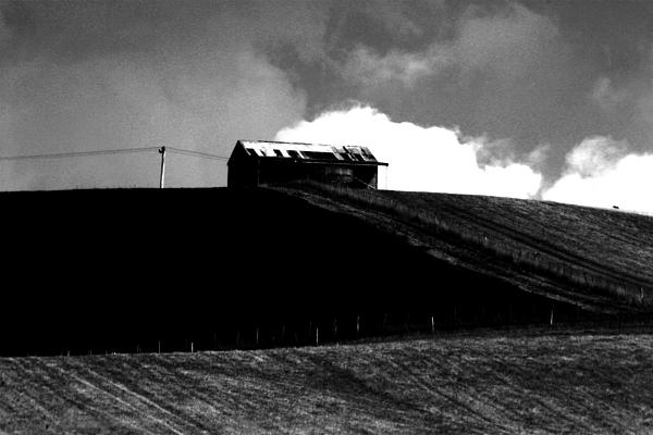 Ranch Building And Clouds Print by Noel Elliot
