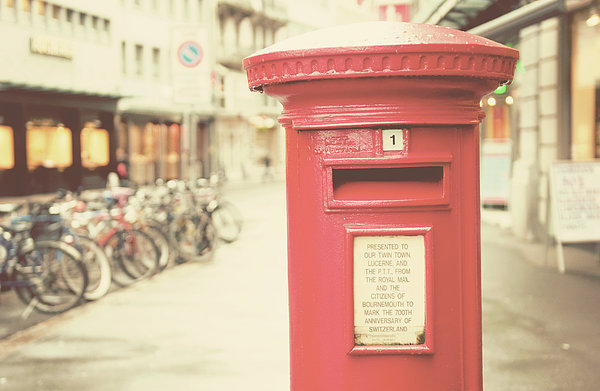 Red English Post Box In Lucerne, Switzerland Print by Copyright Laura Evans. All Rights Reserved.