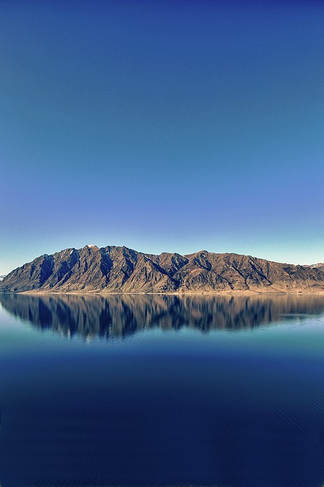 Reflections On Lake Hawea Print by Verity E. Milligan