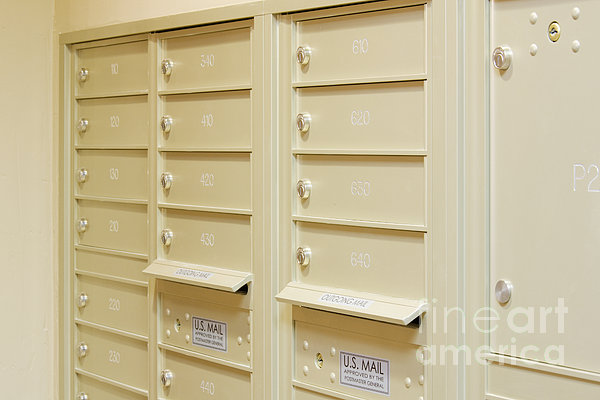 residential mailboxes in apartment building by jeremy
