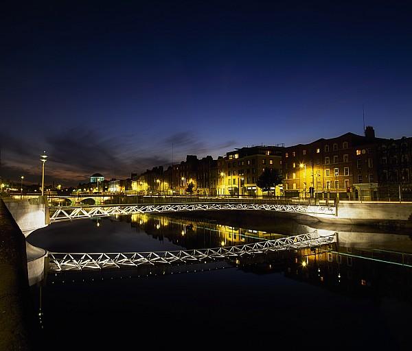 River Liffey, Millenium Footbridge At Print by The Irish Image Collection