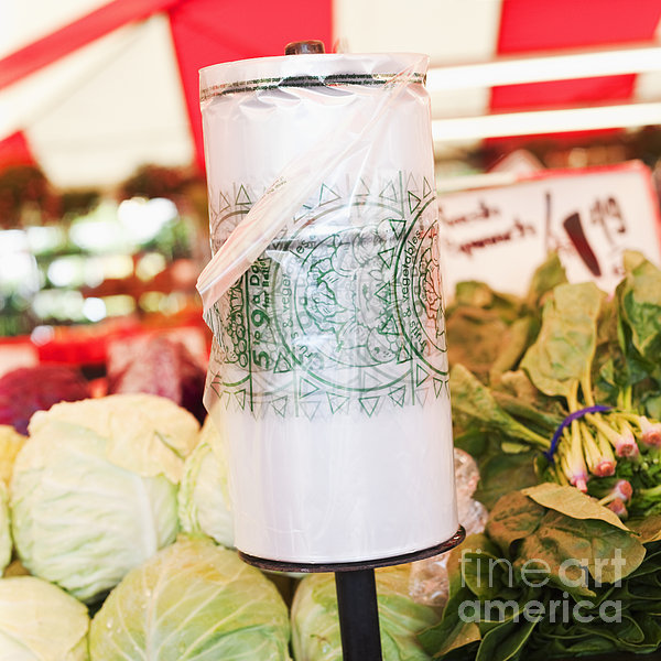 Roll Of Plastic Produce Bags In A Market Print by Jetta Productions, Inc