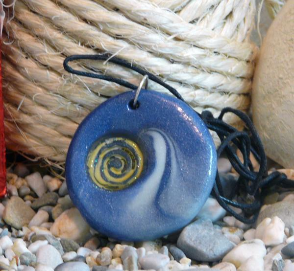 Round Blue Pendant With Spiral Print by Chara Giakoumaki