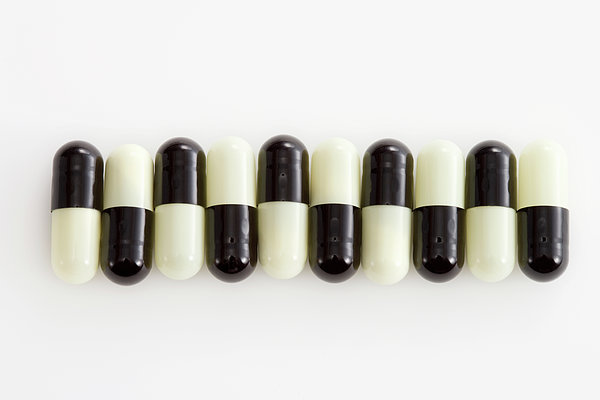 Row Of Black And White Pills Print by Schedivy Pictures Inc.