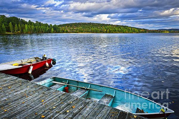 Rowboats On Lake At Dusk Print by Elena Elisseeva