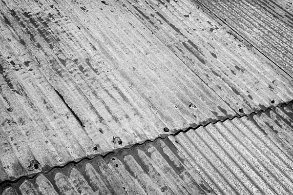 Rusting Repaired Corrugated Iron Roof Sheeting In Edinburgh Print by Joe Fox