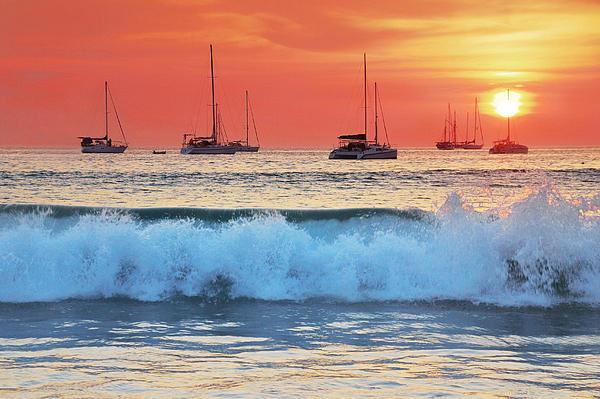 Sea Waves At Sunset Print by Teerapat Pattanasoponpong