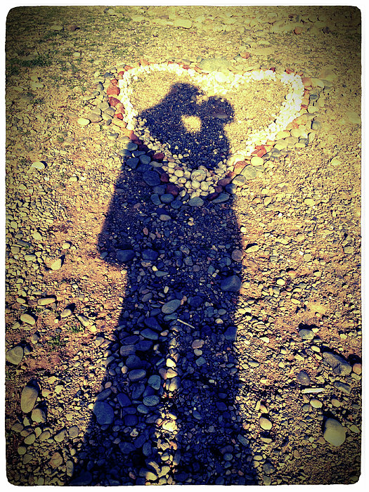 Shadows Of Couple Kissing Over Heart Of Stones Print by Daniel MacDonald / www.dmacphoto.com