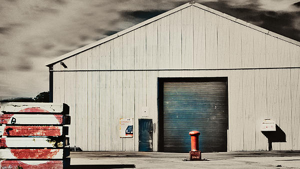 Shed With Bollard And Pallets Print by Harry Neelam