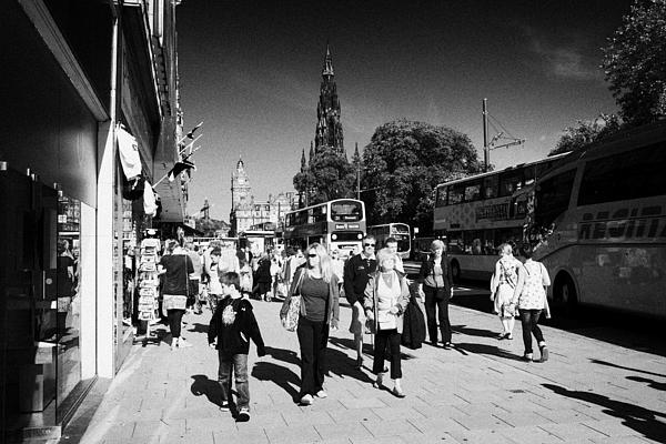 Shoppers And Tourists On Princes Street Edinburgh Scotland Uk United Kingdom Print by Joe Fox