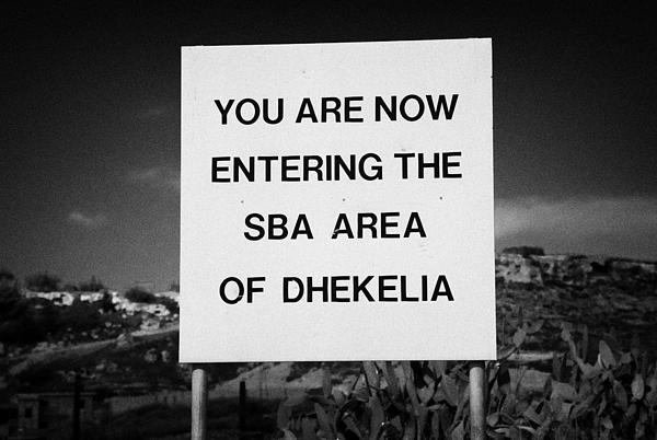 sign marking entrance of SBA Sovereign Base area of Dhekelia in the british controlled cyprus Print by Joe Fox