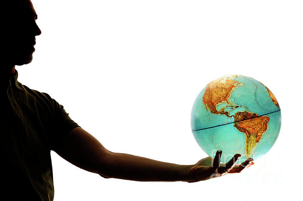 Silhouette Of Man Holding Globe Print by Sami Sarkis