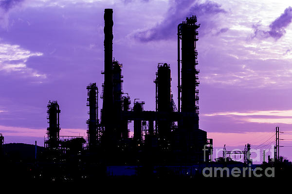 Silhouette Of Oil Refinery Plant At Twilight Morning Print by Mongkol Chakritthakool