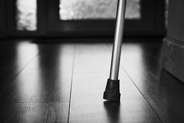 Single Crutch Leg Leaning Against A Wall In A House In The Uk Print by Joe Fox