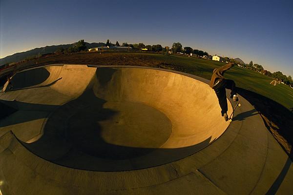 Skateboarding In A Skate Park Print by Bill Hatcher