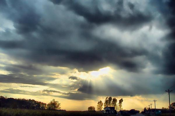 Sky In Turmoil Print by Tom Schmidt