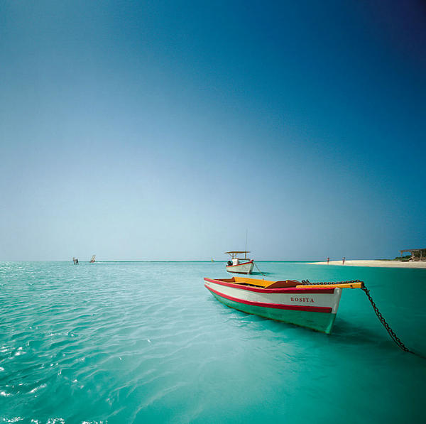 Lanjee Chee - Small Boat Floating On Clear Water