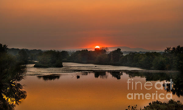 Robert Bales - Smokey sunset on the Payyett River