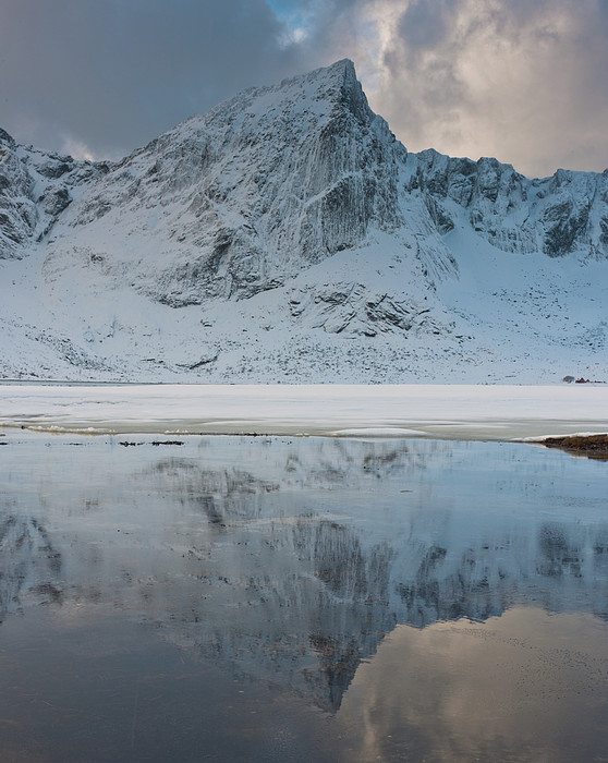 Snow Covered Mountain Reflected In Lake Print by © Peter Boehi