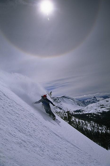Snowboarding Down A Peak In Yosemite Print by Bill Hatcher
