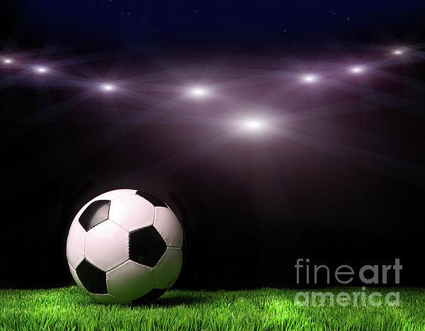 Soccer Ball On Grass Against Black Print by Sandra Cunningham