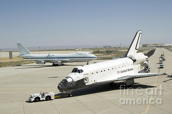 Space Shuttle Atlantis Is Towed by Stocktrek Images