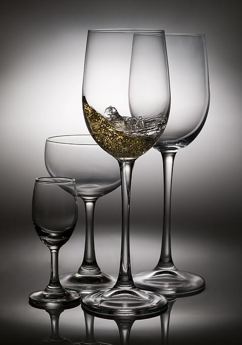 Splashing Wine In Wine Glasses Print by Setsiri Silapasuwanchai