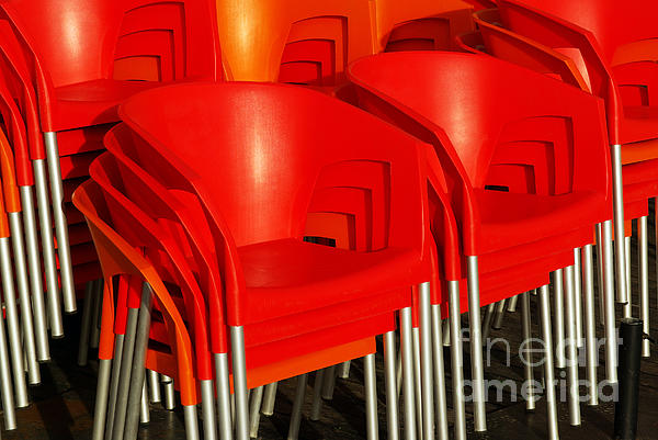 Stacked Chairs Print by Carlos Caetano