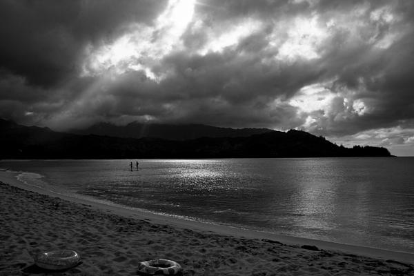 Stand Up Paddlers In Stormy Skies Print by Lennie Green