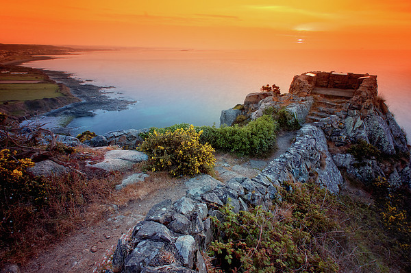 Stone Wall By Atlantic Ocean At Sunset Print by Haaghun