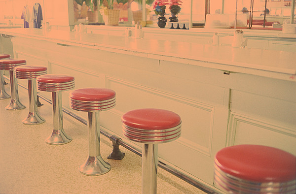 Stools At Bar Counter Print by Carol Whaley Addassi