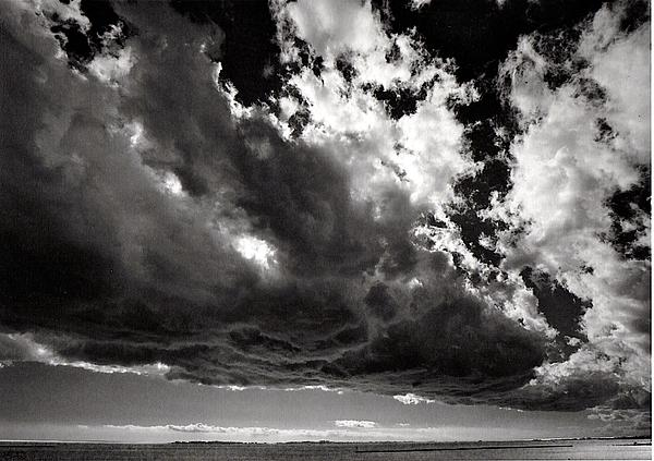 Storm Cloud Over The Harbor Print by Raymond Uzanas