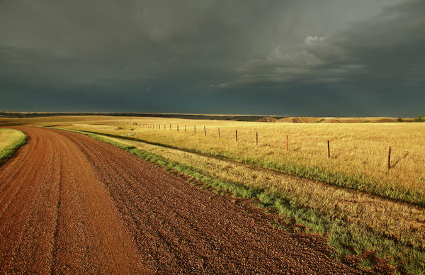 Storm Clouds Along A Saskatchewan Country Road Print by Mark Duffy